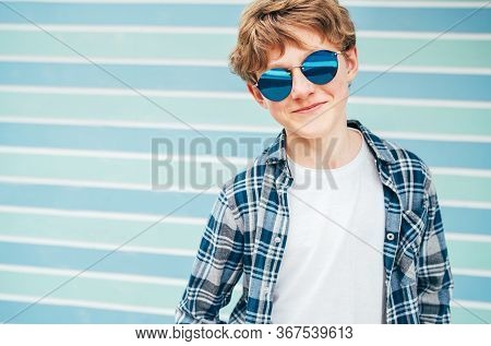 Blonde Hair 12 Year Old Caucasian Teenager Boy Fashion Portrait Dressed White T-shirt With Checkered