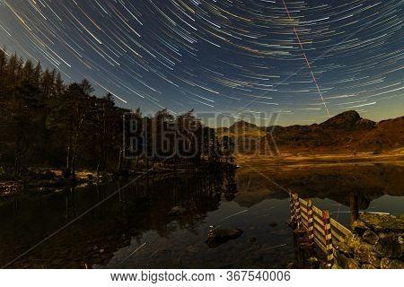 Star Trails Over Blea Tarn On A Moonlit Night