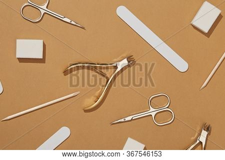 Pattern Of Cosmetic Accessories For Nails, Scissors, Pusher Cuticle, Cotton And Dried Flowers. Top V