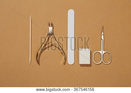 Manicure Tools Are Laid Out In One Line In The Center Of The Frame. Cosmetic Accessories For Nails,