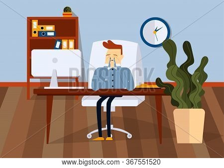 Upset Businessman Sitting On Office Chair At A Computer Desk. He Is He Cries And Wipes His Tears Wit