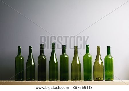 empty wine bottles, gray background