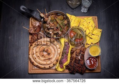 Patella, Domestic Sausage, Meat, Shashlik, Kebab, Salt Pancakes, Pickled Orugs And Tomatoes And Sauc
