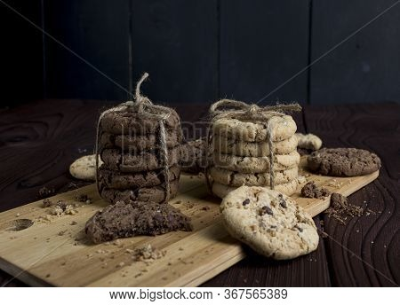 Delicious Light And Dark Cookies, Stacked And Tied With A String On A Wooden Background. Delicious C