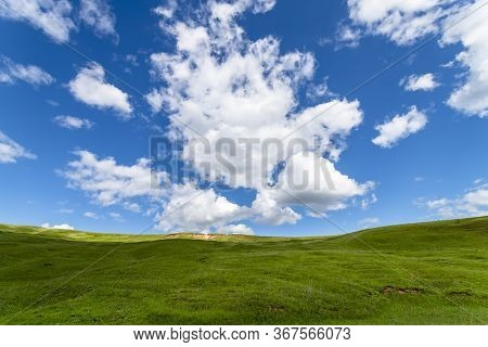 Green Hills Against The Blue Sky With Clouds. Beautiful Screensaver.