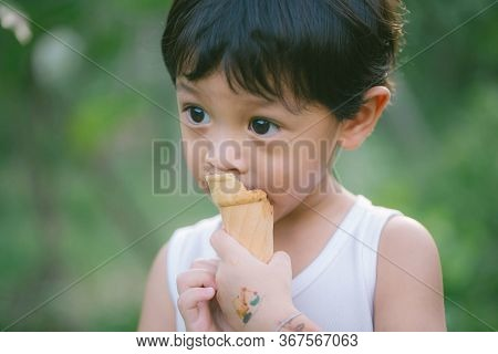 Asia Boy He Mouth Aftertaste From Eating Chocolate Ice Cream  Or Chocolate Dessert. A Sweet-toothed