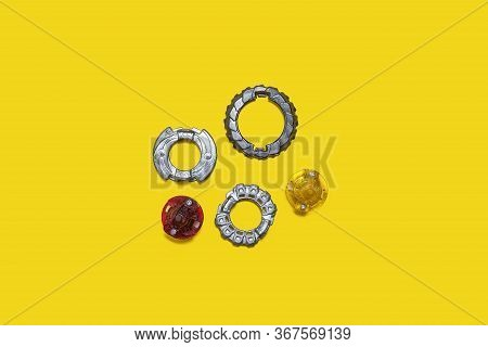 Set Of Popular Kid Boys Toys Over Yellow Background. Rings Of Differend Shapes And Colours