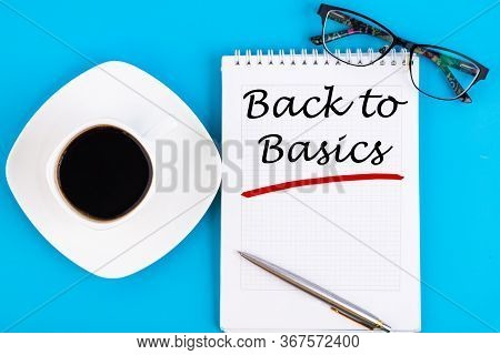The Text, The Inscription, The Phrase Back To Basics Is Written In A Notebook That Lies On A Blue Ta