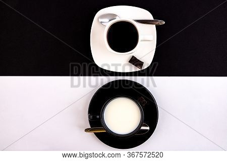 A Black Cup And Saucer On A White Background And A White Cup And Saucer On A Black Background. The C