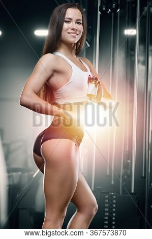 Fitness Woman With Fish Oil Workout In Gym