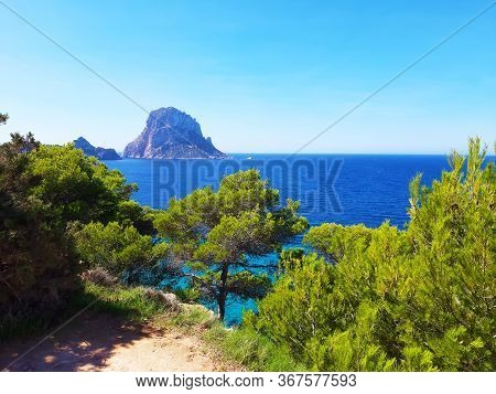Naturalistic Maritime Panorama Of Es Vedra In The Sea Of ​​ibiza From Cala D'hort In Balearic Island