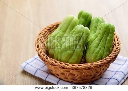Chayote Squash Or Mirlition Squash In Basket, Organic Vegetable