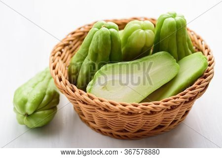 Chayote Squash Or Mirlition Squash In Basket On White Table, Organic Vegetables