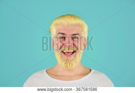 Bearded Man With Dyed Blonde Hair. Blond Hipster Guy. Modern Handsome Man With Blonde Dyed Hair. Ecc