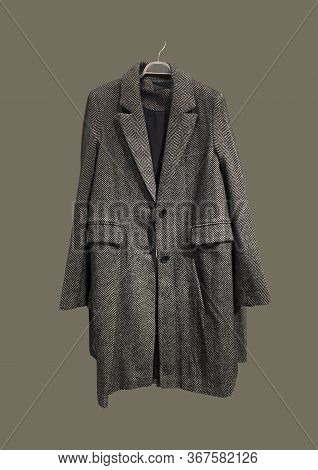 Brown Women Coat On Hangers Isolated On Brown Background. Composition Of Clothes. Flat Lay, Top View