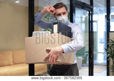 Dismissal Employee In Preventive Medical Mask In An Epidemic Coronavirus. Dismissed Worker Going Fro