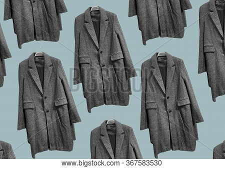 Black And White Women Coat On Hangers Isolated On Blue Background. Composition Of Clothes. Flat Lay,