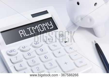 White Calculator, White Piggy And Black Pen With Text Alimony On White Background