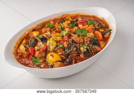Homemade Vegetable Stew Of Eggplant, Zucchini, Tomatoes, Peppers, Garlic, Prunes And Greens On Bowl
