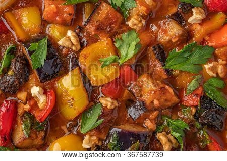 Homemade Vegetable Stew Of Eggplant, Zucchini, Tomatoes, Peppers, Prunes And Greens. Close Up Food B