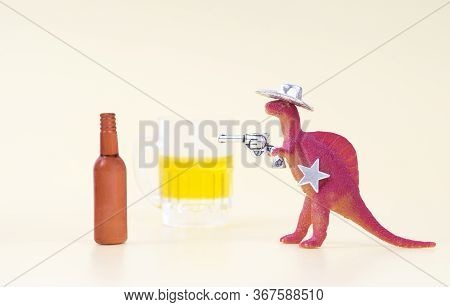 Toy Dinosaur Wearing A Cowboy Hat, Holding A Revolver In His Arm And Having A Sheriff Star Shoots An