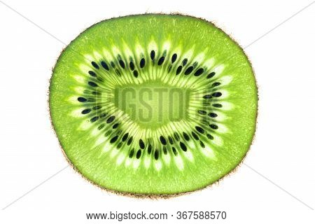 Fresh Kiwi Slice Isolated On White Background. Close-up Shot, Top View. Cross-section Of A Bright Tr