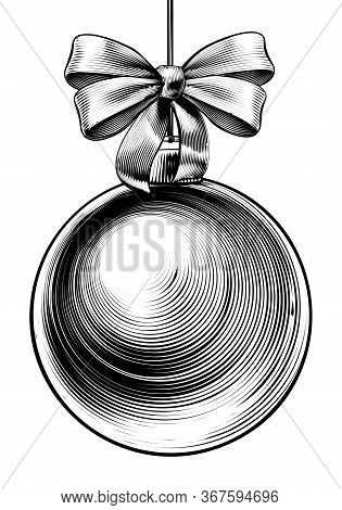 Christmas Bauble And Bow Ribbon In A Vintage Woodcut Engraved Etching Style