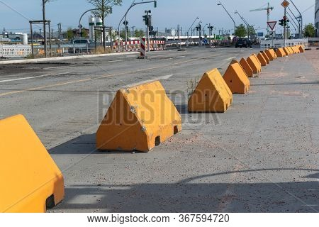 Long Receding Line Of Anti-terror Barricades In The Form Of Large Concrete Triangular Blocks Along A