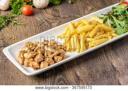 Grilled Cubed Chicken With Pasta And Salad