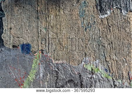 Rough Concrete Wall In Close-up With Peeling Old Grey Paint And With The Pattern Left By Wooden Form