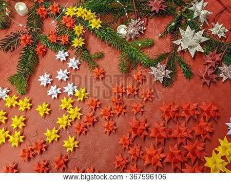 Christmas Background With Colorful Red And Yellow Decorations And Fresh Green Pine Branches Decorate