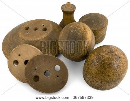 Several Round Hat Shapes Made Of Wood By A Hatter On A White Background.