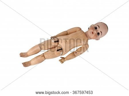 Unidentifiable Doll Without Clothes And Short Hair Lying Over Bright White Background Showing Its Wo