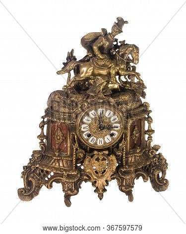 Antique Equestrian Brass Mantle Clock With Ornate Embellishments And Roman Numerals On The Dial Isol