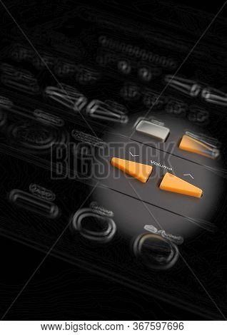 Close Up On Tiny Orange Volume Buttons Attached To Black Plastic Remote Control In Small Circle Of L