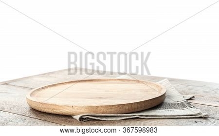 Empty Plate And Napkin On Wooden Table Against White Background