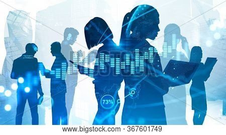 Silhouettes Of Business People Working In Blurry Abstract City With Double Exposure Of Digital Graph