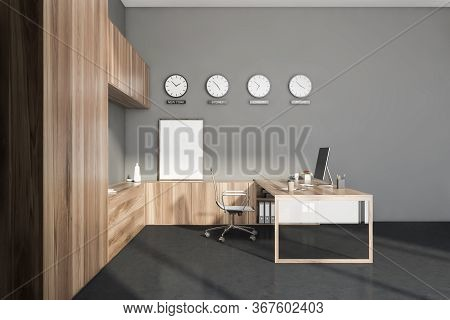 Interior Of Stylish Ceo Office With Grey Walls, Concrete Floor, Wooden Computer Table And Bookcases.