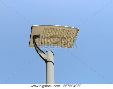 Led Streetlight On A Pole Against Clear Blue Sky Background. Modern Energy-saving Technologies For L