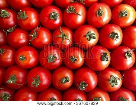 Vegetable Background. Background Of Red Tomatoes. Top View On Ripe Red Tomatoes. Textured Red Natura