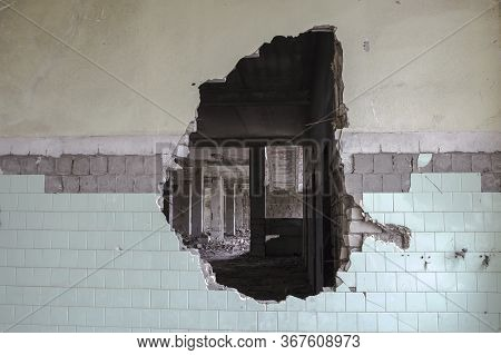 A Hole In The Wall Of A Large Tiled Building. Background