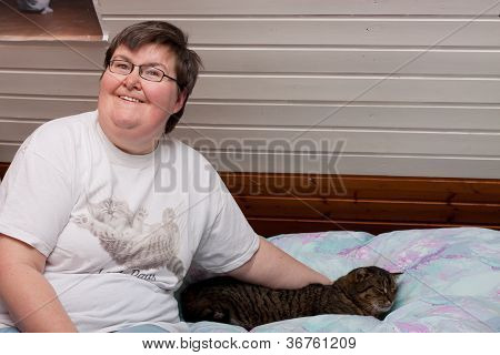 mentaly disabled woman with a cat in her bed poster