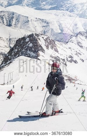 Female Skier Enjoy In Beautiful Snowy Alps Mountain Range Scenic