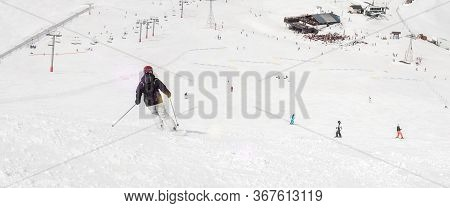 Female Skier Rolls And Ride. Winter Season Sport And Recreation