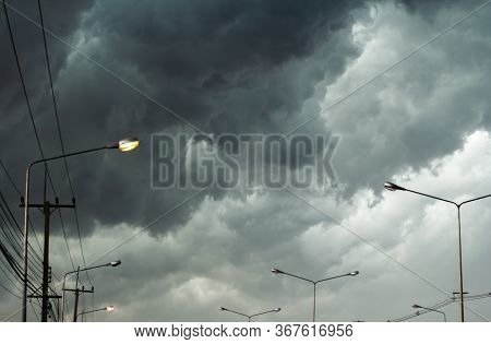 The Dark Sky With Black Clouds Covered Before The Big Storm Will Enter In City. The Big Powerful Sto