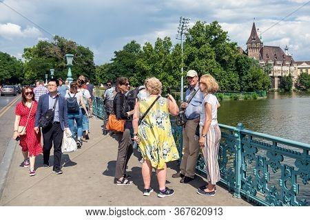 Budapest, Hungary - July 14, 2019: People At Millennium Bridge Near Vajdahunyad Castle In Budapest,