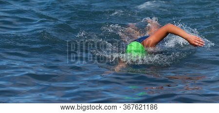 Triathlete Woman Swimming Freestyle Crawl In Ocean, Female Triathlon Swimmer Swimming In Professiona