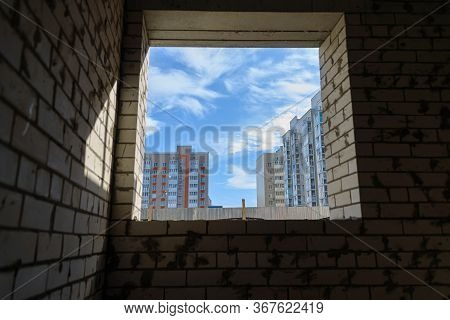 View From The Window Of An Unfinished House On New Multi-storey Buildings. Photographed On A Wide An