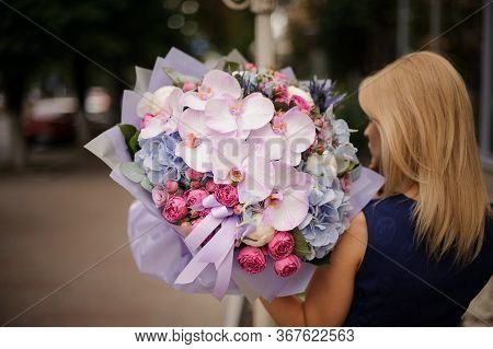 Back View Of Blonde Girl With Big Magnificent Bouquet