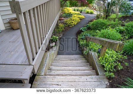 Looking Down Railroad Tie Steps To A Sidewalk At A Condo Complex In Spring. Lifestyle Concept Image